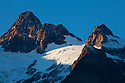 Dramatic light on mountain peaks, Tour de Mont Blanc, French Alps, France.