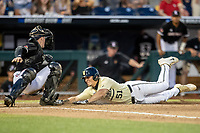 Vanderbilt Commodores outfielder JJ Bleday (51) slides home with the game tying run as Louisville Cardinals catcher Henry Davis (32) attempts to tag him during the ninth inning of the NCAA College World Series on June 21, 2019 at TD Ameritrade Park in Omaha, Nebraska. Vanderbilt defeated Louisville 3-2 to head to the CWS Finals. (Andrew Woolley/Four Seam Images)