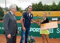 2013-08-17, Netherlands, Raalte,  TV Ramele, Tennis, NRTK 2013, National Ranking Tennis Champ,  Olga Kalyuzhnaya receives runner up prize from match leader Floris Killian<br /> <br /> Photo: Henk Koster