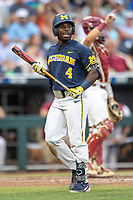 Michigan Wolverines second baseman Ako Thomas (4) walks back to the dugout during Game 6 of the NCAA College World Series against the Florida State Seminoles on June 17, 2019 at TD Ameritrade Park in Omaha, Nebraska. Michigan defeated Florida State 2-0. (Andrew Woolley/Four Seam Images)