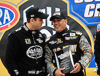 Sept. 16, 2011; Concord, NC, USA: NHRA top fuel dragster driver Tony Schumacher (right) talks with Larry Dixon during qualifying for the O'Reilly Auto Parts Nationals at zMax Dragway. Mandatory Credit: Mark J. Rebilas-US PRESSWIR
