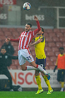 21st November 2020; Bet365 Stadium, Stoke, Staffordshire, England; English Football League Championship Football, Stoke City versus Huddersfield Town; Nick Powell of Stoke City is tackled by Richard Stearmen of Huddersfield Town