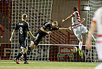 Tony Andreu cuts the ball into an empty net to score for Hamilton as Barry Robson and Willo Flood flounder