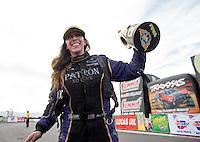Feb 23, 2014; Chandler, AZ, USA; NHRA funny car driver Alexis DeJoria celebrates after winning the Carquest Auto Parts Nationals at Wild Horse Pass Motorsports Park. Mandatory Credit: Mark J. Rebilas-USA TODAY Sports