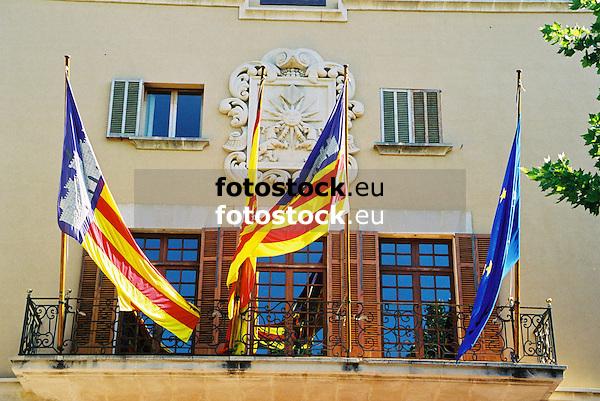 Flags of the Balearic Islands, Spain and the European Union at the balcony of the town hall of Sóller<br /> <br /> Banderas de las Islas Baleares, España y Europa en el balcón del Ayuntamiento de Sóller<br /> <br /> Fahnen der Balearen, Spanien und Europa am Balkon des Rathauses von Sóller<br /> <br /> 1840 x 1232 px