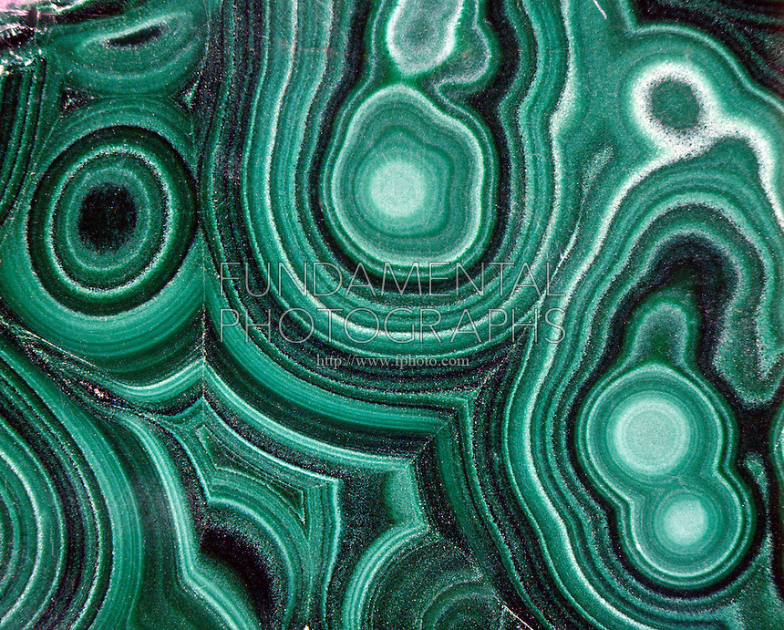 MALACHITE - SECONDARY (SUPERGENE) COPPER ORE<br /> Cu2(OH)2CO3<br /> Specimen shows concentric growth rings. Intense green color indicates presence of copper.