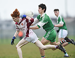 Reece Power of  St Declan's Kilmacthomas in action against Aidan Mc Carthy of  Ennistymon CBS during their Munster C Colleges football final at Rathkeale. Photograph by John Kelly.