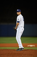 Charlotte Stone Crabs relief pitcher Adrian Navas (15) gets ready to deliver a pitch during a game against the Palm Beach Cardinals on April 20, 2018 at Charlotte Sports Park in Port Charlotte, Florida.  Charlotte defeated Palm Beach 4-3.  (Mike Janes/Four Seam Images)