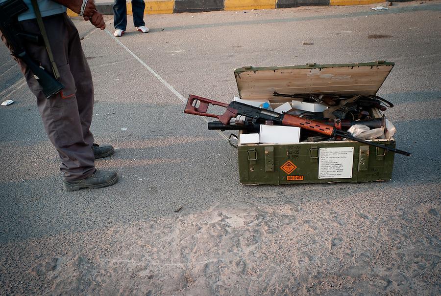 Looting weapons from the Bab Al Aziziya compound in Tripoli, Libya