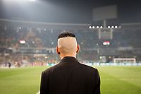 A security guard watches over the pitch during a Chinese Super League football match between Beijing Guo'an and Shanghai Shenhua, at the Worker's Stadium in Beijing. 2nd April, 2017.