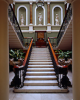 The palatial splendour of the staircase in the central galleried Hall with its Corinthian columns, niches and statuary