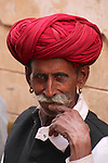 "This handsome man wears a traditional Rajasthani turban, or ""pagari"" which has variants of size, colour, and style. They indicate a wearers social class, caste, and where they come from."