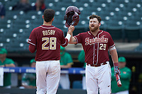 Dylan Busby (28) celebrates a run against Quincy Nieporte (29) against the Notre Dame Fighting Irish in Game Four of the 2017 ACC Baseball Championship at Louisville Slugger Field on May 24, 2017 in Louisville, Kentucky. The Seminoles walked-off the Fighting Irish 5-3 in 12 innings. (Brian Westerholt/Four Seam Images)