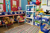 MR / Schenectady, New York. Yates Arts-in-Education Magnet School (urban public school). First grade classroom. Attractive reading area in early childhood classroom includes books, chairs, and stuffed animals. MR: AM-g1w. ID: AM-g1w. © Ellen B. Senisi.