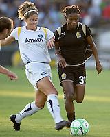 Lisa Sari (left) and Formiga (31) battle for the ball. LA Sol and FC Gold Pride tied 0-0 at Buck Shaw Stadium in Santa Clara, California on July 23, 2009.