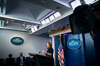 White House Press Secretary Jen Psaki answers reporter questions during a news conference in the James S. Brady Press Briefing Room at the White House in Washington, D.C., U.S., on Friday, September 24, 2021. President Biden faces another border crisis as thousands of Haitians try to cross into the U.S. from Mexico, and his administration's response has sparked harsh criticism from fellow Democrats over what they see as inhumane treatment of the migrants. <br /> Credit: Al Drago / Pool via CNP /MediaPunch