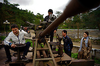 Young Vietnamese visitors play on an anti-aircraft relic at a monument marking the Vietnamese effort along the Ho Chi Minh Trail in Dong Loc, Vietnam on 22 February 2010.
