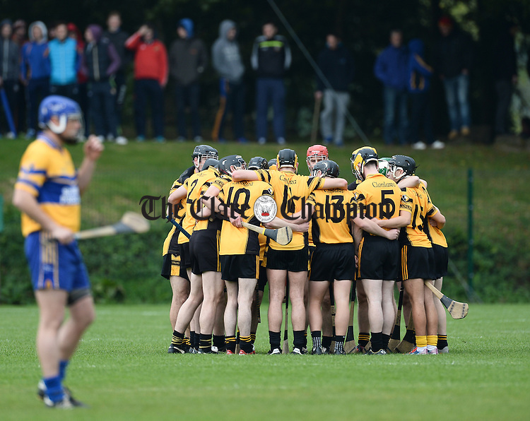 The Clonlara team in a huddle before they beat Sixmilebridge in the Junior A final at Broadford. Photograph by John Kelly.
