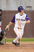 Trent Whitehead #1 of the East Carolina Pirates follows through on his swing versus the Elon Phoenix at Clark-LeClair Stadium March 29, 2009 in Greenville, North Carolina. (Photo by Brian Westerholt / Four Seam Images)