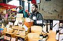 London, UK. 25.10.2014. Male stallholder on a cheese stall at Borough Market, Southwark. Photograph © Jane Hobson.