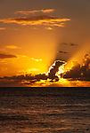 The setting sun behind clouds ion the remote island of Kiritimati in Kiribati.
