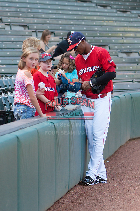 Jimmy Paredes (17) signing autographs before the MiLB matchup between the Sacramento River Cats and the Oklahoma City Redhawks at Chickasaw Bricktown Ballpark on August 12th, 2012 in Oklahoma City, Oklahoma. The River Cats defeated the Redhawks 3-1  (William Purnell/Four Seam Images)