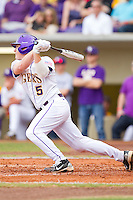Mason Katz #5 of the LSU Tigers follows through on his swing against the Wake Forest Demon Deacons at Alex Box Stadium on February 19, 2011 in Baton Rouge, Louisiana.  The Tigers defeated the Demon Deacons 4-3.  Photo by Brian Westerholt / Four Seam Images