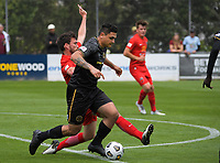 Action from the ISPS Handa Men's Premiership football match between Team Wellington and Canterbury Dragons at David Farrington Park in Wellington, New Zealand on Saturday, 19 December 2020. Photo: Dave Lintott / lintottphoto.co.nz