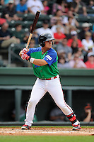 Third baseman Michael Chavis (11) of the Greenville Drive bats in a game against the Augusta GreenJackets on Sunday, April 12, 2015, at Fluor Field at the West End in Greenville, South Carolina. Chavis is a first-round pick of the Boston Red Sox in the 2014 First-Year Player Draft. Augusta won, 2-1. (Tom Priddy/Four Seam Images)