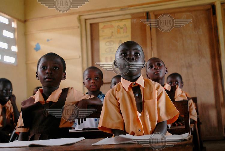 Schoolchildren listen in class at Abompekrom School.