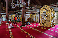 Yogyakarta, Java, Indonesia.  Interior of the Great Mosque, Masjid Gedhe Kauman, mid-18th. Century, showing the Minbar on the right, from which the imam giives the Friday Sermon.  The mihrab. indicating the direction of Mecca, is in the middle.