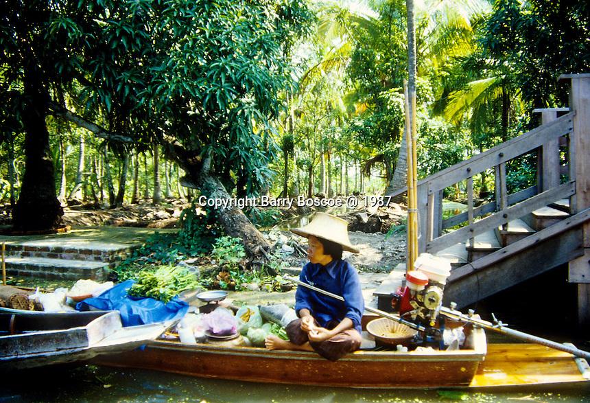 Selling produce on the floating market outside of Bangkok, Thailand