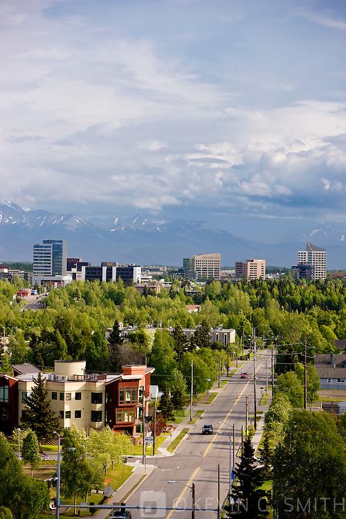 View of midtown Anchorage looking south toward the Kenai Mountains, summer, Anchorage, Southcentral Alaska, USA.