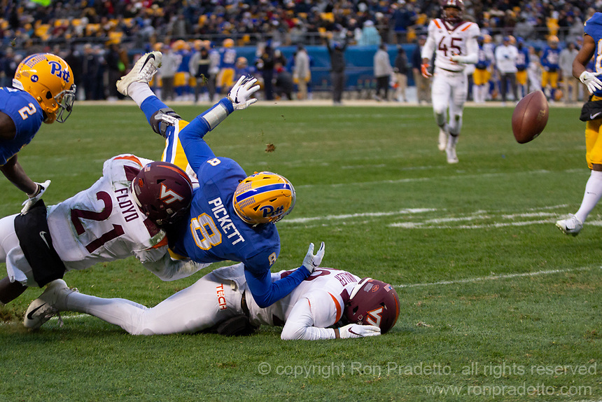 Virginia Tech defensive backs Reggie Floyd (21) and Jermaine Waller (28) force a fumble by Pitt quarterback Kenny Pickett at the goal line. The Pitt Panthers defeated the Virginia Tech Hokies 52-22 on November 10, 2018 at Heinz Field in Pittsburgh, Pennsylvania.