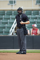 Home plate umpire Tanner Moore between innings of the South Atlantic League game between the Greensboro Grasshoppers and the Piedmont Boll Weevils at Kannapolis Intimidators Stadium on June 16, 2019 in Kannapolis, North Carolina. The Grasshoppers defeated the Boll Weevils 5-2. (Brian Westerholt/Four Seam Images)