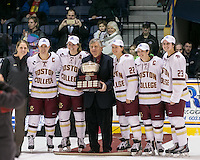 North Andover, Massachusetts - March 6, 2016: NCAA Division I, Women's Hockey East final. Boston College (white/maroon) defeated Boston University (red), 5-0, at Lawler Arena at Merrimack College. Boston College has a perfect Hockey East season - regular season, Bean Pot winner, and Women's Hockey East winner. Women's Hockey East cup presented to Boston College coach and captains.
