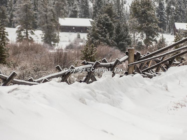 A fence runs through the Montana countryside.