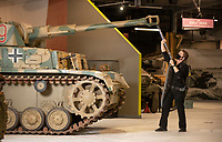 BNPS.co.uk (01202) 558833. <br /> Pic: CorinMesser/BNPS<br /> <br /> Pictured: Jon Giles uses his Ghostbusters style backpack vacuum to clean a Panzer IV tank. <br /> <br /> Staff at the Tank Museum, Bovington are deep cleaning the exhibits ahead of reopening on Monday (17/05/21).