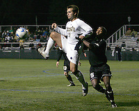 Kurt Martin #11 of Notre Dame leaps up to collect a pass in front of Adam Brent #5 of Oakland. The University of Notre Dame defeated Oakland University 2-1 in the second round of the NCAA championship at Alumni Field at the University of Notre Dame in South Bend, Indiana on November 28, 2007.