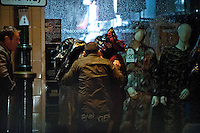 Saturday 21 December 2013<br /> Pictured: People shelter from the rain, one even resorting to using a carrier bag. <br /> Re: Black Friday Drinkers