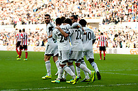Saturday 19 October 2013 Pictured: Swansea team mates celebrate <br /> Re: Barclays Premier League Swansea City vSunderland at the Liberty Stadium, Swansea, Wales