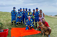 BNPS.co.uk (01202) 558833. <br /> Pic: PaulHolmes/BNPS<br /> <br /> Pictured: Safe and hound... Milo with his family and the Lulworth and Kimmeridge Coastguard rescue teams after the rescue. <br /> <br /> A dog had a lucky escape after it fell 65ft off a cliff at a hugely popular beauty spot.<br /> <br /> Milo the golden labrador was walking with his family at the top of the 200ft cliff at Durdle Door in Dorset on Monday afternoon when he suddenly disappeared over the edge.<br /> <br /> Thankfully the spot where he fell was a steep slope rather than a sheer drop and he managed to stop 65ft down the cliff.
