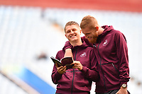 George Byers (left) and Oli McBurnie (right) of Swansea City share a joke prior to the Sky Bet Championship match between Aston Villa and Swansea City at Villa Park in Birmingham, England, UK.  Saturday 20 October  2018