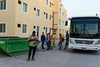QATAR, Doha, housing complex for migrant worker outside the city / KATAR, Doha, Gastarbeiter, Sammelunterkunft fuer Gastarbeiter ausserhalb der Stadt, transfer per Bus zwischen Baustelle und Unterkunft