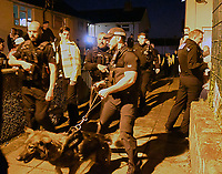 Pictured: Police officers in Monkton, Pembrokeshire, Wales, UK. Tuesday 11 July 2017<br /> Re: A riot broke out in a quiet country village when more than 200 protesters threw stones and lit fires outside the house of a woman they suspected of being a sex offender.<br /> The angry mob shouting 'paedo' and 'nonce' were broken up by at about 4am when the 24-year-old woman and another person were escorted from the house by armed police.<br /> The crowd had gathered in Monkton, Pembrokeshire just after 9pm on Tuesday night after a series of sex allegations against the woman were made on Facebook.
