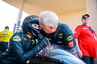 Jul 19, 2019; Morrison, CO, USA; NHRA pro stock motorcycle rider Jianna Salinas with crew during qualifying for the Mile High Nationals at Bandimere Speedway. Mandatory Credit: Mark J. Rebilas-USA TODAY Sports
