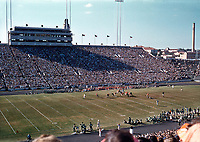 In this vintage October 1955 photo the University of Texas Longhorn Football Team plays a unnamed team at the UT football field stadium in downtown Austin, Texas.