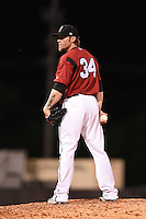 Nashville Sounds pitcher Michael Blazek (34) looks in for the sign during the second game of a double header against the Omaha Storm Chasers on May 21, 2014 at Herschel Greer Stadium in Nashville, Tennessee.  Nashville defeated Omaha 13-4.  (Mike Janes/Four Seam Images)