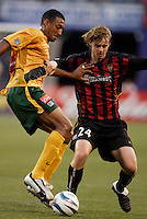The Galaxy's Tyrone Marshall and the MetroStars' Eddie Gaven go for the ball. The NY/NJ MetroStars defeated the LA Galaxy 3 to 0 during MLS action at Giant's Stadium, East Rutherford, NJ, on August 8, 2004.