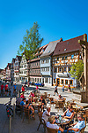 Deutschland, Bayern, Unterfranken, Ochsenfurt: Hauptstrasse mit Cafés und Fachwerkhaeuser in der gut erhaltenen Altstadt | Germany; Bavaria; Lower Franconia; Ochsenfurt: main street with cafés and half-timbered houses